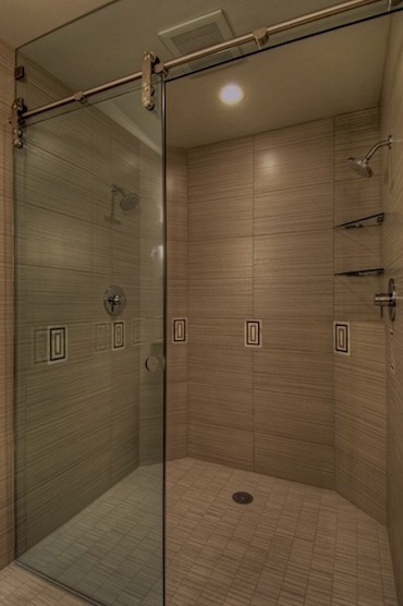 Custom designed bathroom by Terrell Lozada for Lake Sammamish, Washington property. Walker Zanger tiles, Waterworks faucets.  View of shower.