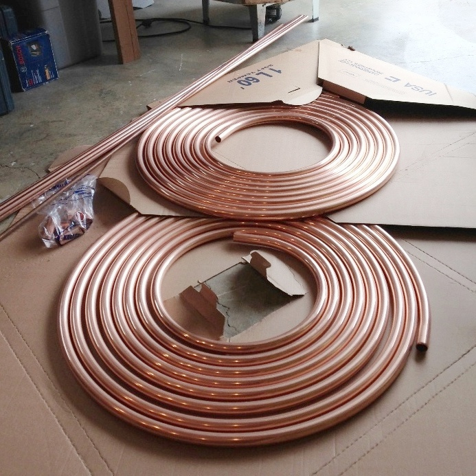 "120 feet of 1"" copper refrigeration tubing and 70 feet of rigid copper pipe. Total weight about 75 lbs. I love copper based metals for their sensitivity, integrity and color"